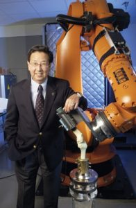 Dr. Savio Woo with a robotic/Universal-Force Sensor testing system. – University of Pittsburgh